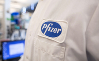 The Pfizer logo on the lab coat of an employee. MUST CREDIT: Bloomberg photo by Scott Eisen