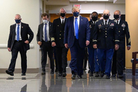 President Donald Trump visiting Walter Reed National Military Medical Centre in Bethesda, Maryland, on July 11, wearing a mask for the first time since the Covid-19 outbreak. Wearing a mask in the US has been described as a political issue, not a medical necessity.PHOTO: NYT