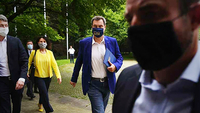 Markus Soeder, Bavaria's premier (center) wears a protective face mask featuring a Bavarian coat of arms as he arrives for a news conference in Munich , on July 23, 2020. MUST CREDIT: Bloomberg photo by Andreas Gebert.