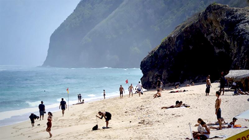 Tourists visit Melasti Beach in Badung regency, Bali, on June 24. (Antara/Fikri Yusuf)