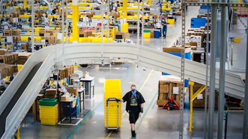 The Kent fulfillment center in May. Amazon has seen a slip in market share amid the pandemic. MUST CREDIT: photo for The Washington Post by Jovelle Tamayo.
