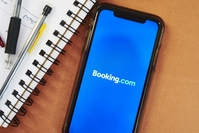 The logo for Booking.com is displayed on a smartphone on May 10, 2020. MUST CREDIT: Bloomberg photo by Gabby Jones. Location: New York, United States