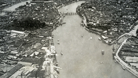 A view of a section of Hiroshima flanking the Motoyasu River after the bombing. Except for very heavy masonry structures, the entire area was leveled. MUST CREDIT: National Archives