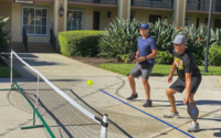 Referee Scott Foster, right, has turned his passion for pickleball into an organized competition among NBA officials to help pass time during a three-month stay inside the Disney World bubble. MUST CREDIT: Washington Post photo by Ben Golliver