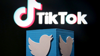 A 3D-printed Twitter logo is placed in front of a displayed Tik Tok logo in this illustration picture taken Aug 9, 2020. [Photo/Agencies]