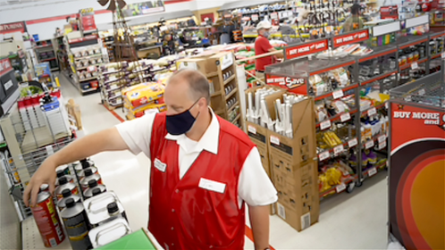 Tim Linch, store manager at Tractor Supply Co., straightens merchandise in Leesburg, Va., on July 30. The company is thriving either despite or because of the pandemic. CREDIT: Washington Post photo by Katherine Frey.