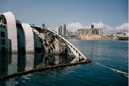 A boat that capsized during the Aug. 4 explosion floats in the port of Beirut on Tuesday. MUST CREDIT: Photo by Lorenzo Tugnoli for The Washington Post
