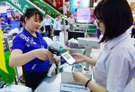 A customer makes a payment using e-wallet at a supermarket in HCM City. With more customers using e-wallets, mobile banking and web applications, banks and financial service providers need to build their cyber defences intelligently, cybersecurity company Kaspersky has warned. — Photo courtesy of nld.com.vn