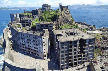 An aerial view taken from a drone shows the partially collapsed Building No. 30, right, on Hashima island, better known as Gunkanjima, in Nagasaki on Thursday. CREDIT: Japan News-Yomiuri photo