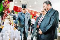 Brunei Darussalam BIMP-EAGA Business Council (BDBEBC) Chairman Pengiran Haji Haris bin Pengiran Haji Duraman takes a closer look at Bersuci Sertu Wash, a new local product. PHOTO: BAHYIAH BAKIR