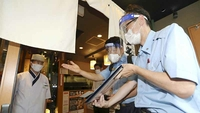 Fire department officials visit a restaurant in Nagoya, Japan, on Aug. 5, 2020, to advise on measures to prevent infections with the novel coronavirus. MUST CREDIT: Yomiuri Shimbun