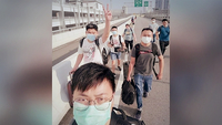 Some of the 10 Malaysian staff employed by Gain City walking across the Causeway last Monday when the border reopened. They are serving seven-day, stay-home notices and will start work if their swab test results come back negative.PHOTO: GAIN CITY