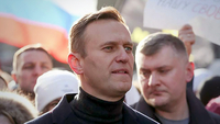 Russian opposition leader Alexei Navalny walks with demonstrators during a rally in Moscow on Feb. 29, 2019. MUST CREDIT: Bloomberg photo by Andrey Rudakov