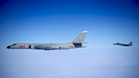 PLA Air Force flies a bomber to conduct island patrols over the South China Sea in this file photo taken on Nov 23, 2017. [Photo/Xinhua]
