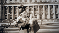 A letter carrier walks in front of the D.C. City Post Office in April 1957. The building is now home to the Smithsonian's National Postal Museum. MUST CREDIT: Library of Congress