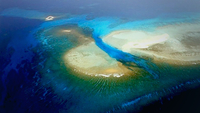 This June 1, 2011 bird's eye view shows the coral reefs in China's Xisha Islands. The Xisha Islands lie in the middle of South China Sea, consisting of Xuande Islands and Yongle Islands. (PHOTO / XINHUA)