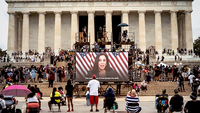 Democratic vice-presidential candidate Kamala Harris appears on a screen during the
