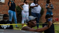 Locals record a news conference on Wednesday, Sept. 3, 2020, regarding a fatal police shooting in Washington two days prior. MUST CREDIT: Washington Post photo by Demetrius Freeman