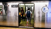 Commuters enter a New York subway train in June 2020. MUST CREDIT: Bloomberg photo by Nina Westervelt