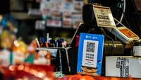 A sign for digital payment service Ant Financial's Alipay, an Alibaba affiliate, in front of a payment terminal of a store in Hong Kong on July 21, 2020. MUST CREDIT: Bloomberg photo by Lam Yik