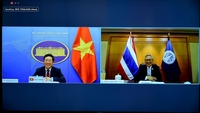 Deputy Prime Minister and Foreign Minister Phạm Bình Minh, left, and Thai Foreign Minister Don Pramudwinai during a virtual talk on Thursday. — VNA/VNS Photo