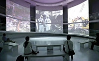 Footage of nuclear reactor decommissioning work is shown at a museum scheduled to open Sept. 20 in Futaba, Fukushima Prefecture, on Saturday. (The Yomiuri Shimbun)