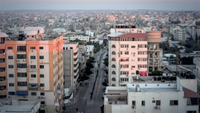 A photo from the top of Al-Wehda Street in Gaza City, considered the area's busiest street for traffic, is nearly empty on Aug. 25 because of the lockdown. CREDIT: photo for The Washington Post by Loay Ayyoub.
