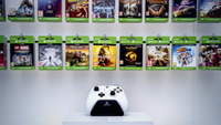 An Xbox One controller sits on display below gaming passes at a Microsoft store in London on July 9, 2019. CREDIT: Bloomberg photo by Chris J. Ratcliffe.