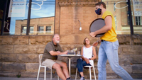 Kristen and Rush Burpee of Michigan relax with drinks outside Pittsburgh's Wigle Whiskey. Owner Meredith Meyer Grelli doesn't blame the state, but says,