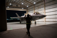 An F-35A Lightning II fighter jet is directed out of a hangar at Al-Dhafra Air Base in the United Arab Emirates in 2019. (Tech. Sgt. Jocelyn Ford/U.S. Air Force/AP)