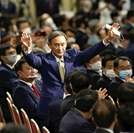 Chief Cabinet Secretary Yoshihide Suga reacts to applause after being elected president of the Liberal Democratic Party on Monday. (The Yomiuri Shimbun)
