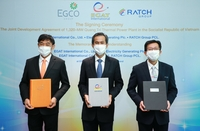 From left: Egco Group's president Thepparat Theppitak, acting president of Egat International Santichai Osotpavapusit and Ratch Group's chief executive officer Kijja Sripatthangkura pose after signing the joint development pact.