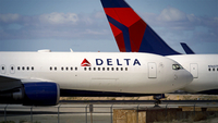 Delta Air Lines Inc. aircraft sit parked at a field in Victorville, Calif., on March 23, 2020. MUST CREDIT: Bloomberg photo by Patrick T. Fallon.