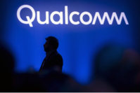 Nakul Duggal, senior vice president of automotive product management at Qualcomm Technologies Inc., is silhouetted while speaking during the company's news conference at the 2019 Consumer Electronics Show (CES) in Las Vegas on Jan. 7, 2019. MUST CREDIT: Bloomberg photo by David Paul Morris.
