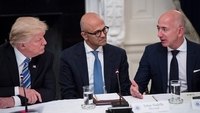 President Trump speaks with Microsoft chief executive Satya Nadella and Amazon chief executive Jeff Bezos in the State Dinning Room at the White House in 2017. MUST CREDIT: Washington Post photo by Jabin Botsford