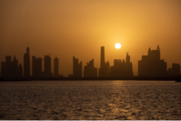 The sun sets beyond residential and commercial skyscrapers, seen from Dubai Creek Harbour Development in Dubai, United Arab Emirates, on Sept. 6, 2020. CREDIT: Bloomberg photo by Christopher Pike.