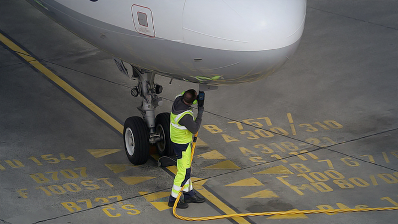 A ground crew member connects a fuel hose to a Deutsche Lufthansa Airbus A321 aircraft at Tegel airport in Berlin on March 13, 2019. MUST CREDIT: Bloomberg photo by Krisztian Bocsi