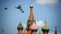 A Mil MI-26 heavy transport helicopter, center, flies over the Kremlin during the victory day parade in Moscow on June 24, 2020. MUST CREDIT: Bloomberg photo by Andrey Rudakov.