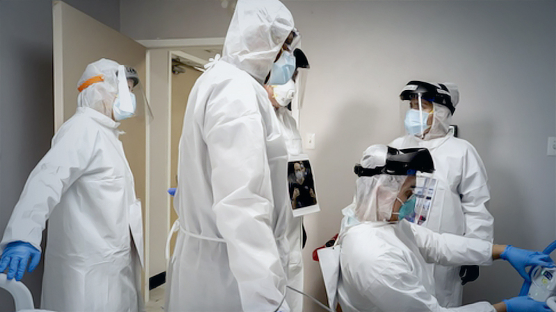 Doctors and nurses wearing protective gear treat a patient in the covid-19 intensive care unit (ICU) at the United Memorial Medical Center in Houston on June 29, 2020. MUST CREDIT: Bloomberg photo by Go Nakamura.