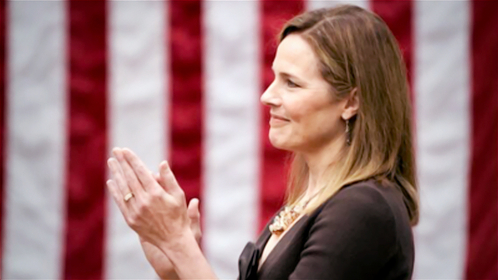 Judge Amy Coney Barrett applauds as President Trump announces her nomination to the Supreme Court on Saturday night at the White House. MUST CREDIT: Washington Post photo by Jabin Botsford