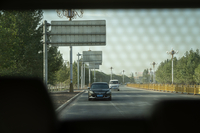 A Washington Post reporter and two colleagues were obviously followed by about a dozen cars during their trip to Kashgar.  CREDIT: Photo by Lorenz Huber for The Washington Post.