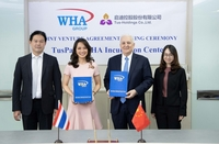 WHA Group executives pose with the contract