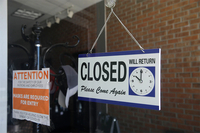 In July, a closed sign hangs in the window of a barber shop in Burbank, Calif, California lost more than 2,6 million jobs in March and April because of the coronavirus. (Marcio Jose Sanchez/ AP)