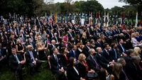 Staff and visitors listen as President Donald Trump speaks with Judge Amy Coney Barrett during a ceremony in the Rose Garden on Sept 26. MUST CREDIT: Washington Post photo by Jabin Botsford