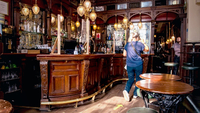 A customer walks through the bar area at St Stephen's Tavern pub in London on Sept. 22, 2020. MUST CREDIT: Bloomberg photo by Chris J. Ratcliffe.