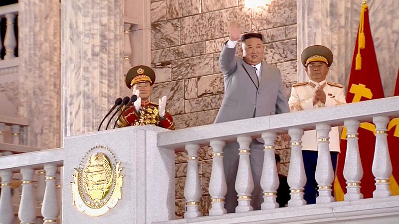 North Korean leader Kim Jong-un waves to soldiers at a military parade in Pyongyang on Saturday. (KCNA-Yonhap)
