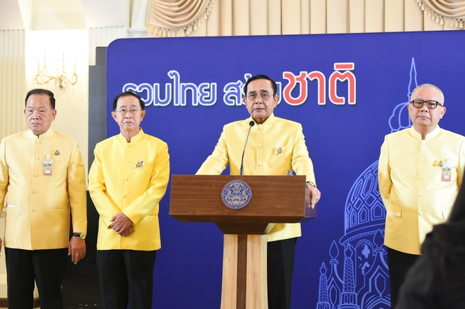 Prime Minister Prayut Chan-o-cha, second right, seen during the announcement of Monday's Cabinet decisions.