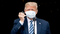 President Donald Trump removes his mask as he arrives to speak to supporters at the White House on Saturday, Oct. 10, 2020. MUST CREDIT: Washington Post photo by Jabin Botsford