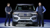Jim Hackett, former president and CEO of Ford., right, speaks as Jim Farley, current CEO, stands next to a 2020 Explorer SUV in Detroit, Mich., on Jan. 9, 2019. MUST CREDIT: Bloomberg photo by Jeff Kowalsky.