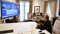 Malaysian Prime Minister Tan Sri Muhyiddin Yassin holding a live video conference with Chinese Foreign Minister Wang Yi (screen display, right) and Foreign Minister Datuk Seri Hishammuddin Tun Hussein (screen display, centre) at his residence on Tuesday (Oct 13). - Bernama